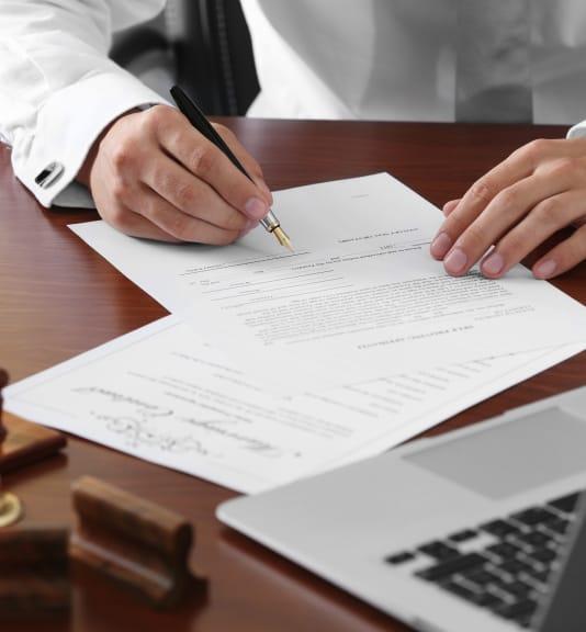 gentleman signing paperwork