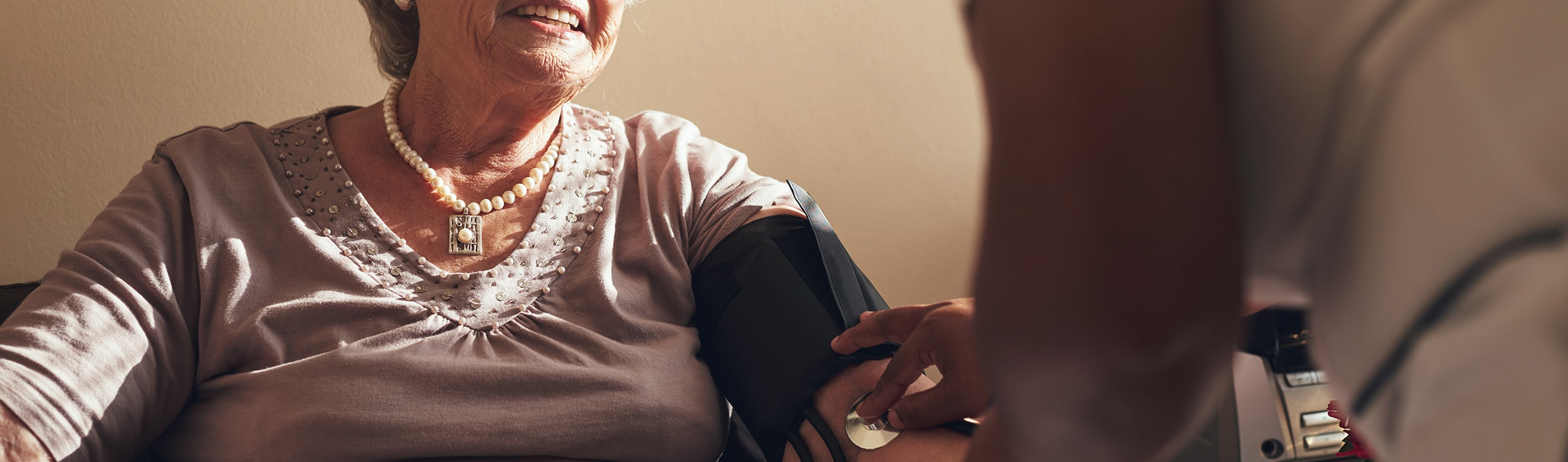 close-up of woman getting her blood pressure taken