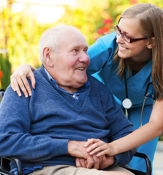 close-up of home healthcare nurse hugging elderly man