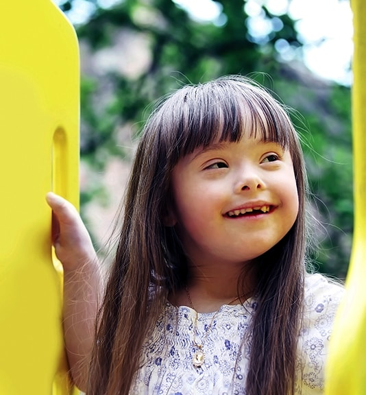 little girl with special needs smiling
