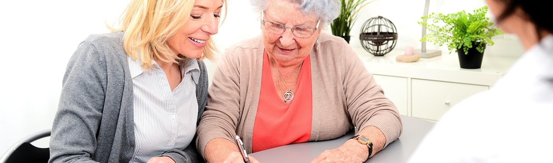 close up of elderly woman writing trust
