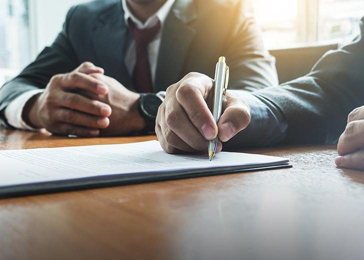 man signing estate plan