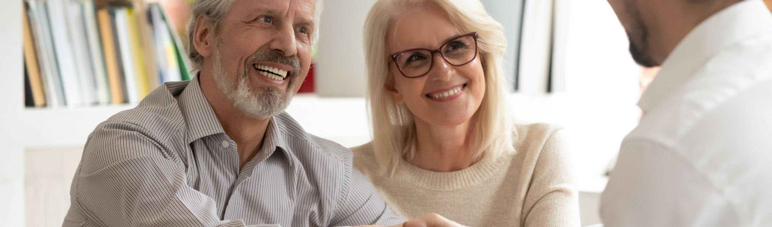 couple meeting with professional to discuss irrevocable trust disadvantages and advantages